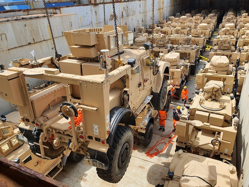 A Mine Resistant Ambush Protected All Terrain Vehicles, or M-ATV, is lowered into the hull of the Ocean Giant cargo vessel at the Port of Livorno in Italy. The 405th Army Field Support Brigade's Army Field Support Battalion-Africa was responsible for prepping, preparing and moving over 1,300 M-ATVs from its Army Prepositioned Stock-2 site at Leghorn Army Depot to be shipped to other locations for other missions. (U.S. Army photo courtesy of the 839th Transportation Battalion)