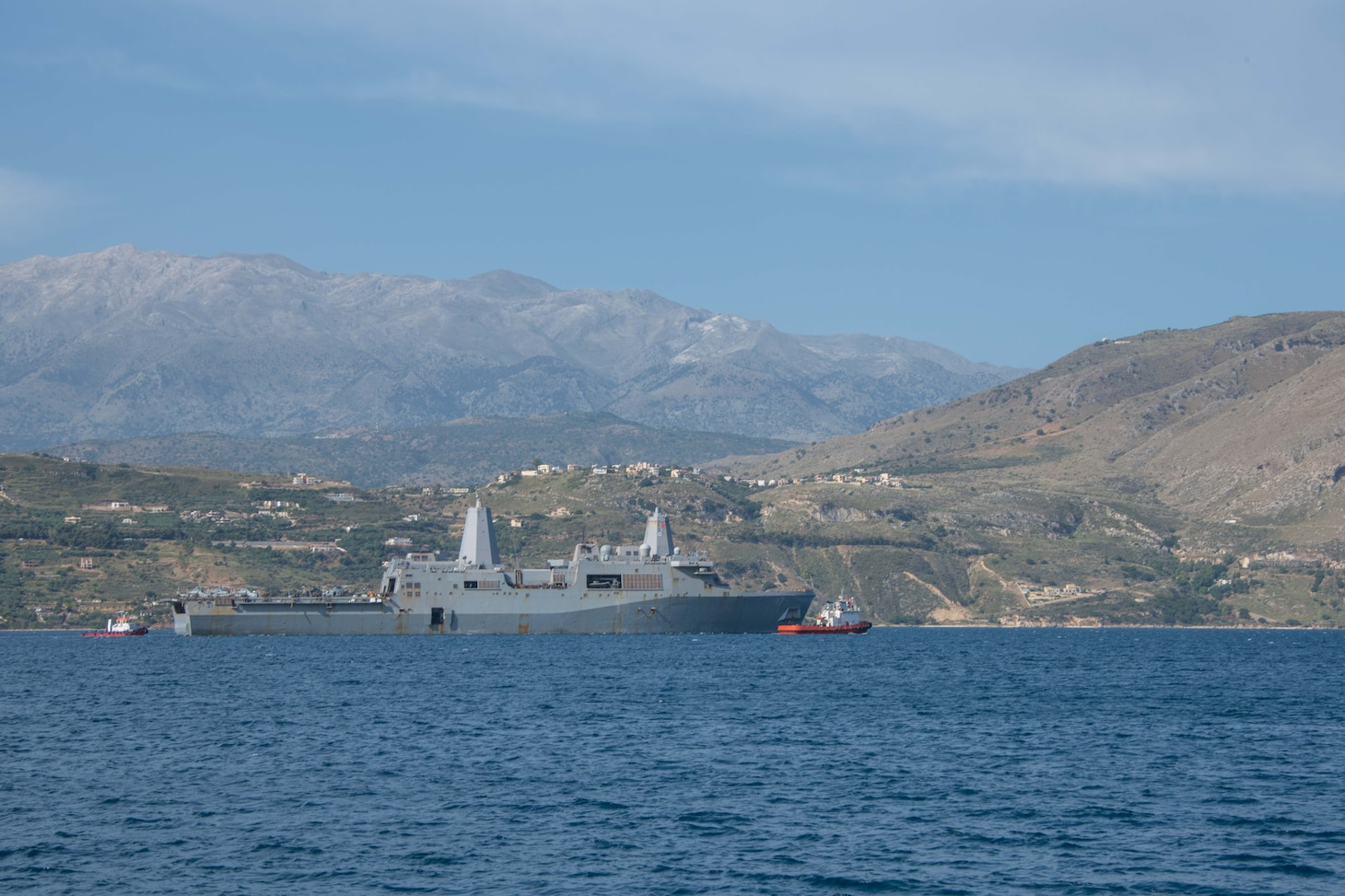 ) The amphibious transport dock ship USS San Antonio (LPD 17) arrives in Souda Bay, Greece, for a scheduled logistics and maintenance stop , May 27, 2021. San Antonio is operating in the U.S. Sixth Fleet area of operations with Amphibious Squadron 4 and the 24th Marine Expeditionary Unit (MEU) as part of the Iwo Jima Amphibious Readiness Group. NSA Souda Bay is an operational ashore base that enables U.S., allied, and partner nation forces to be where they are needed when they are needed to ensure security and stability in Europe, Africa, and Southwest Asia.