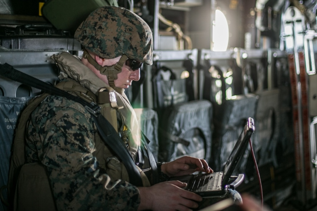 Lance Cpl. Nathan M. Sorenson, a data systems administrator with Command Element, 31st Marine Expeditionary Unit, and a native of Ubly, Michigan, tests the connectivity of the Networking On-the-Move Airborne communications system during flight operations from the amphibious assault ship, USS America (LHA 6), Sept. 22, 2020. The NOTM-A provides the mission commander the ability to command and control forces on the ground while flying above the battlefield. America, flagship of Expeditionary Strike Group 7, along with the 31st MEU, is operating in the 7th fleet area of operations to enhance interoperability with allies and partners and serve as a ready response force to defend peace and stability in the Indo-Pacific region.