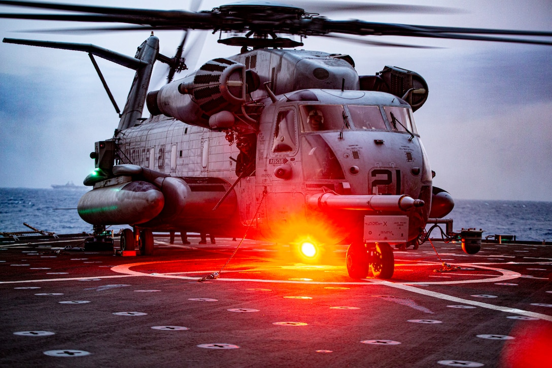 A CH-53E Super Stallion with the 24th Marine Expeditionary Unit is chained down during flight operations on the Harpers Ferry-class dock landing ship USS Carter Hall (LSD 50), May 23, 2021. 24th MEU, embarked with the Iwo Jima Amphibious Ready Group, is forward deployed in the U.S. Sixth Fleet area of operations in support of U.S. national security interests in Europe and Africa.