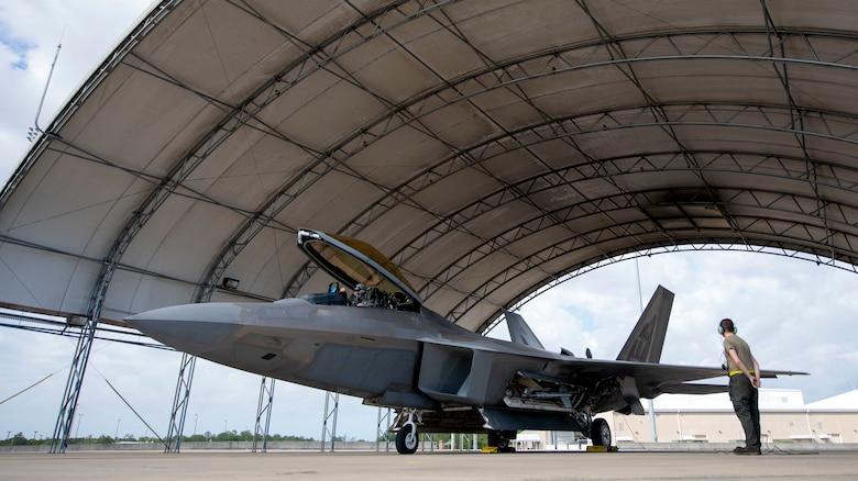 An Airmen prepares an F-22 for flight