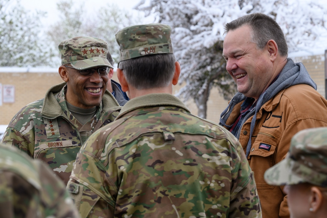 Air Force Chief of Staff Gen. CQ. Brown, Jr., left, U.S. Senator Jon Tester right, and Air Force Global Strike Commander Gen. Timothy M. Ray, make acquaintances May 21, 2021, at Malmstrom Air Force Base, Mont.