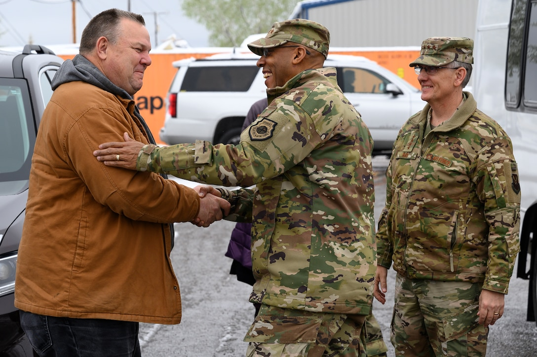 Air Force Chief of Staff Gen. CQ. Brown, Jr., center, meets U.S. Senator Jon Tester left, with Gen. Timothy M. Ray, right, Air Force Global Strike Command commander, May 21, 2021, at Malmstrom Air Force Base, Mont.