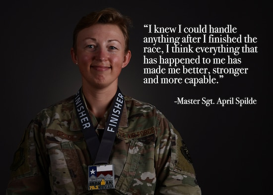 Master Sgt. April Spilde, 22nd Wing Staff Agencies equal opportunity superintendent, poses for a photo with her Iron Man medal April 19, 2021, at McConnell Air Force Base, Kansas. Spilde shared her story of how she used triathlon to overcome challenges throughout her career as part of McConnell's Beyond the Blue initiative. Beyond the Blue focuses on taking steps to normalize the conversations that surround seeking help. (U.S. Air Force photo illustration by Senior Airman Alexi Bosarge)