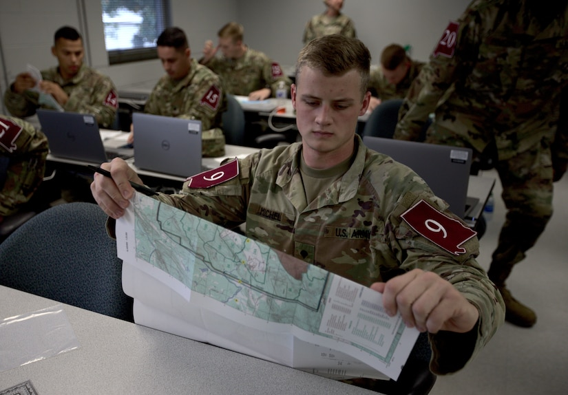 Spc. Dakota Michel participates in a land navigation competition at Fort McClellan, Ala. on May 3, 2021 (Army National Guard photo by Staff Sgt. William Frye).