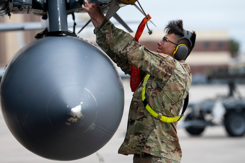 U.S. Air Force Airman secures missile onto aircraft