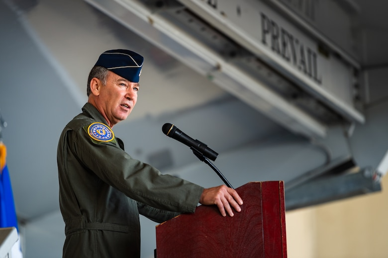 A photo of the 15th Air Force commander speaking at a podium