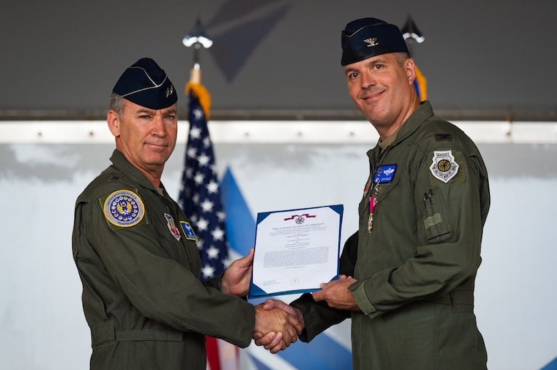 A photo of the 15th Air Force commander presenting the 23d Wing commander with the Legion of Merit