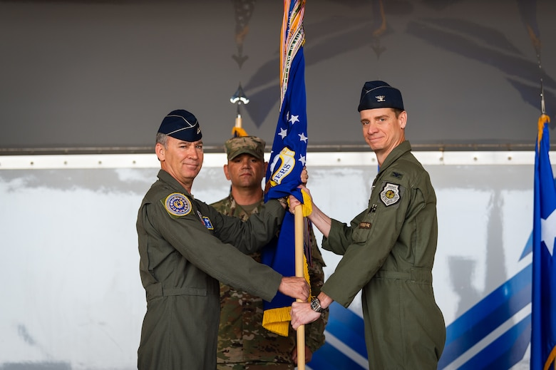 A photo of the 15th Air Force commander passing a guidon to the new 23d Wing commander