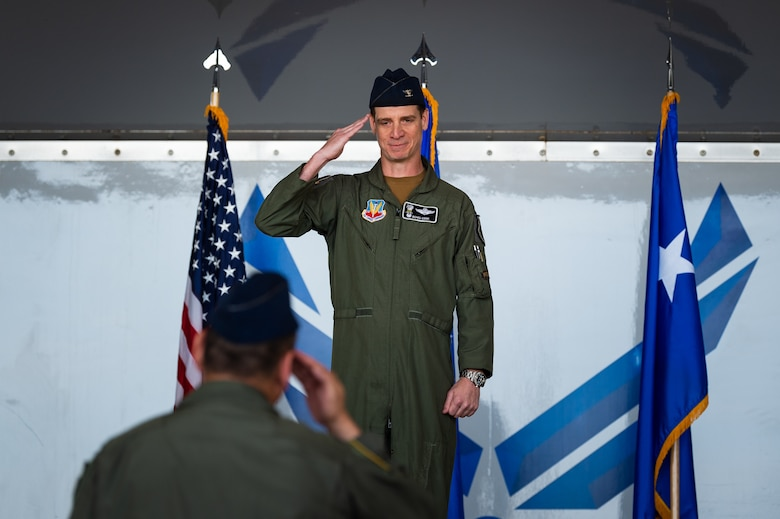 A photo of a commander receiving a salute from a vice commander