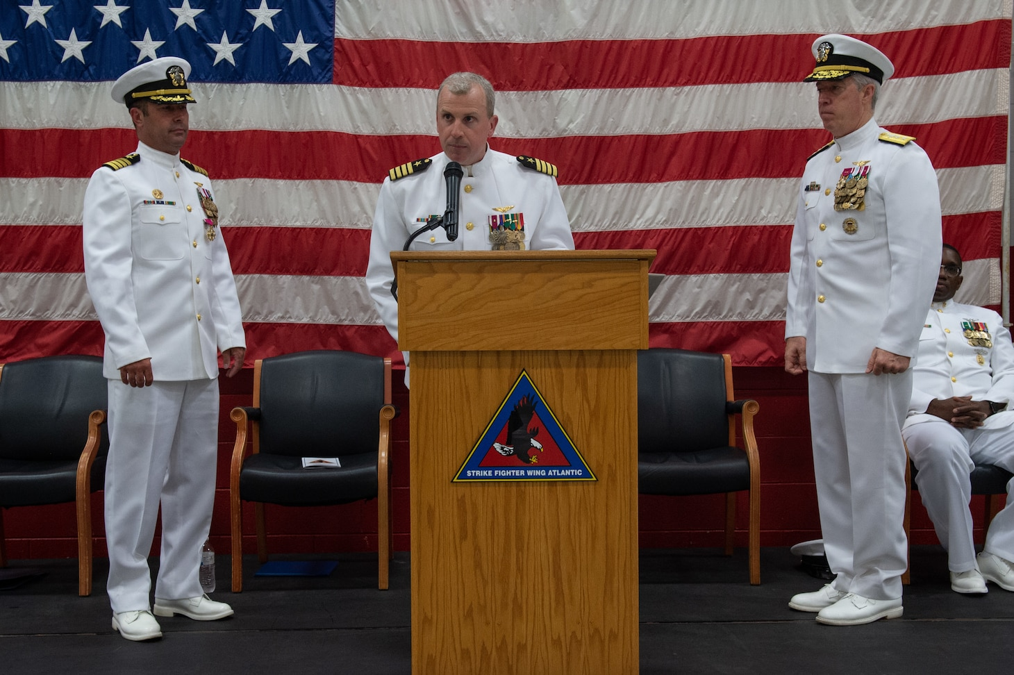 Capt. Ted C. Ricciardella, Commander, Strike Fighter Wing Atlantic (CSFWL), speaks during his change of command ceremony onboard Naval Air Station Oceana. Ricciardella assumes command as commodore of CSFWL from Capt. Brian C. Becker.