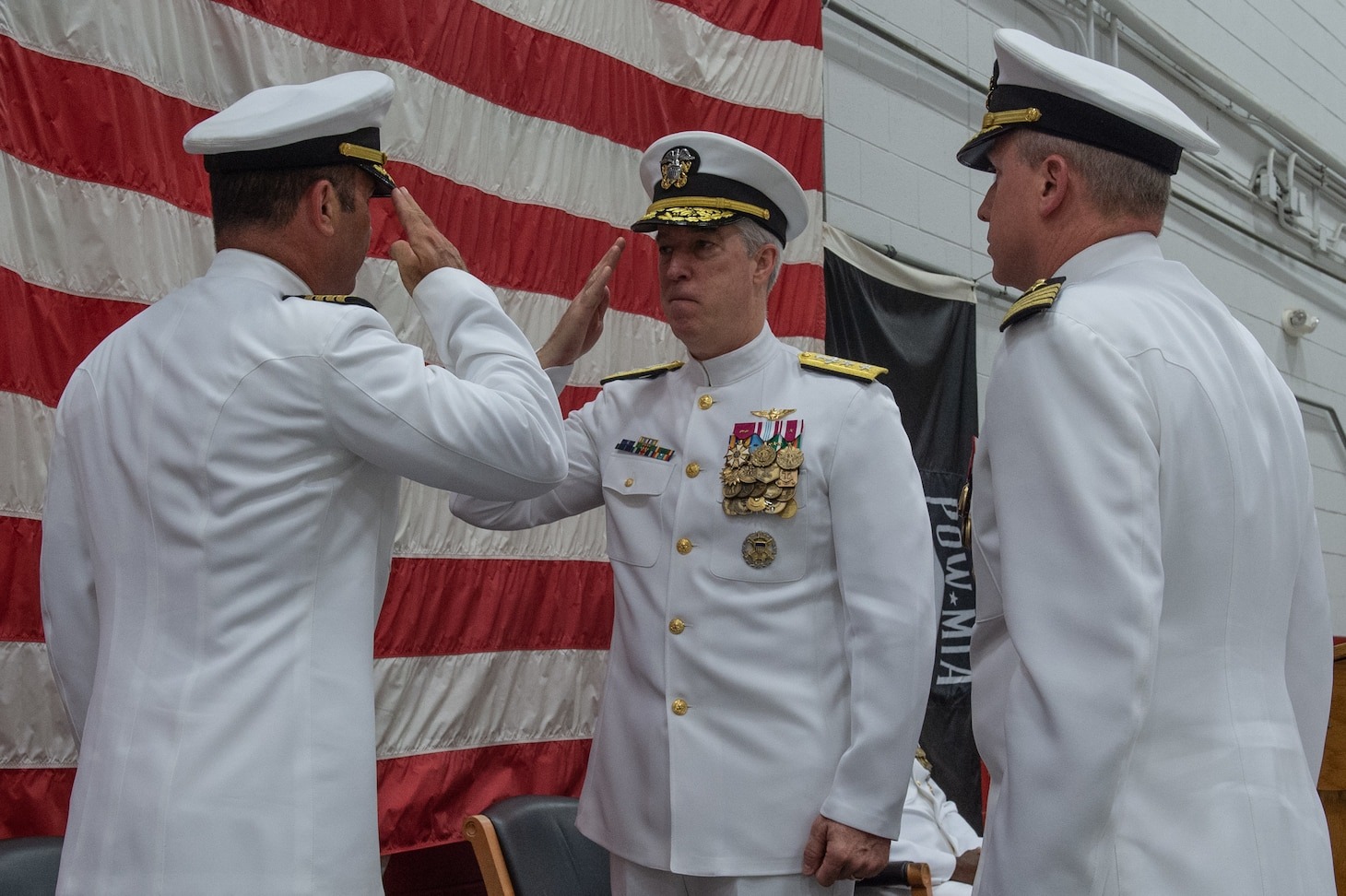 Rear Adm. John F. Meier, Commander, Naval Air Force Atlantic, salutes Capt. Brian C. Becker, outgoing Commander, Strike Fighter Wing Atlantic (CSFWL), during a change of command ceremony