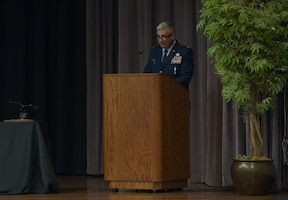 USAF Col. Scott Harron, 193rd Special Operations Mission Support Group commander, speaks to the graduating Specialized Undergraduate Pilot Training class 21-10 May 27, 2021, on Columbus Air Force Base, Miss. Harron manages operations to include civil engineering, disaster preparedness, environmental management, vehicle maintenance, security forces, base services, fuels management, aerial port operations and all other support base functions. (U.S. Air Force photo by Senior Airman Jake Jacobsen)