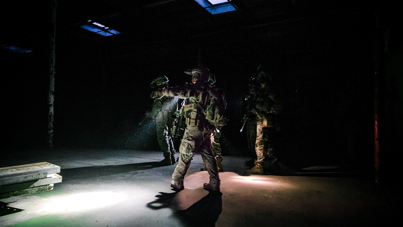 U.S. Marines with 3rd Battalion, 2d Marine Regiment (3/2), 2d Marine Division, and Marine Corps Forces Special Operations Command (MARSOC) search a building during a night raid as a part of Exercise Raven in Nashville, Tenn., May 24, 2021. Exercise Raven is an integrated training event with Marines from 3/2 and MARSOC which simulates real-life tactical scenarios to enhance overall unit interoperability, effectiveness and lethality against an adversarial force. (U.S. Marine Corps photo by Cpl. Patrick King)