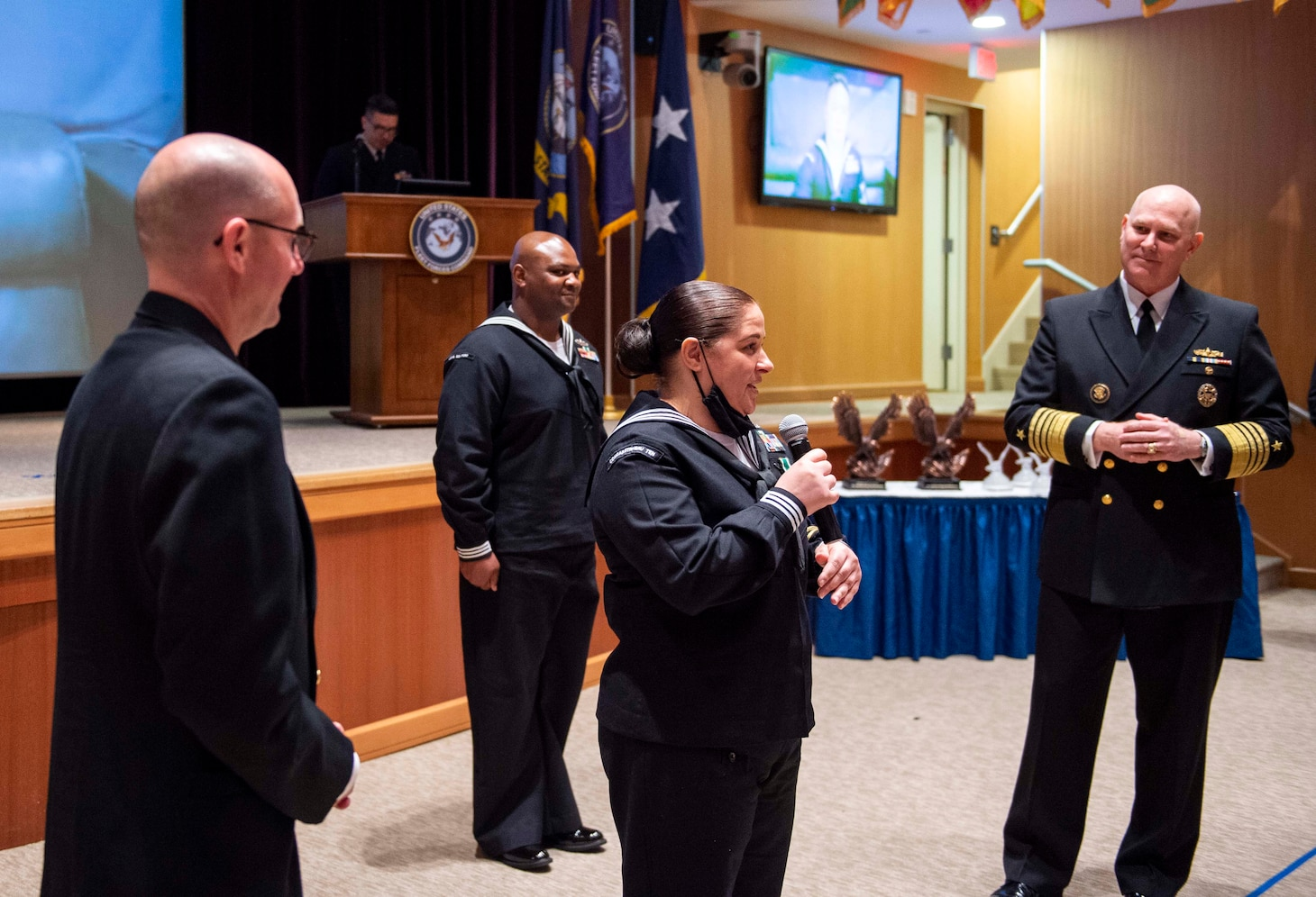 Adm. Christopher W. Grady, commander, U.S. Fleet Forces Command (USFFC), right, and USFFC Fleet Master Chief Rick O�Rawe, left, listen to USFFC 2020 Sea Sailor of the Year (SOY) Personnel Specialist 1st Class Felicia Oxendine, Commander, Carrier Strike Group Ten, center, speak during a ceremony at the Joint Forces Staff College, May 27, 2021.