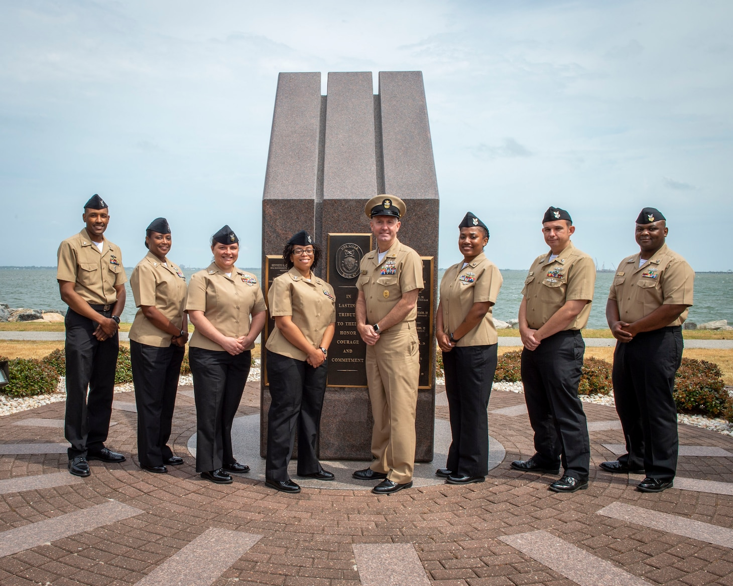 U.S. Fleet Forces Command Fleet Master Chief Rick O�Rawe, center, poses with the 2020 Sea and Shore Sailor of the Year (SOY) finalists during a visit to the USS Cole (DDG 67) memorial at Naval Station Norfolk, May 24, 2021.