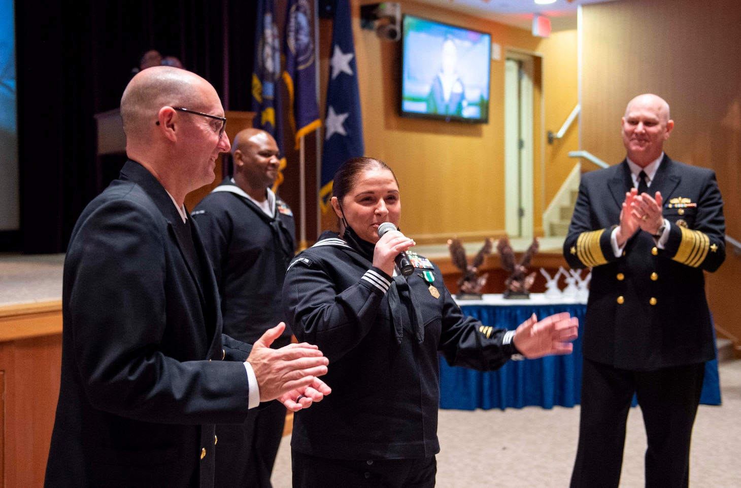 Adm. Christopher W. Grady, commander, U.S. Fleet Forces Command (USFFC), right, and USFFC Fleet Master Chief Rick O�Rawe, left, congratulate USFFC 2020 Sea Sailor of the Year (SOY) Personnel Specialist 1st Class Felicia Oxendine, Commander, Carrier Strike Group Ten, center, during a ceremony at the Joint Forces Staff College, May 27, 2021.