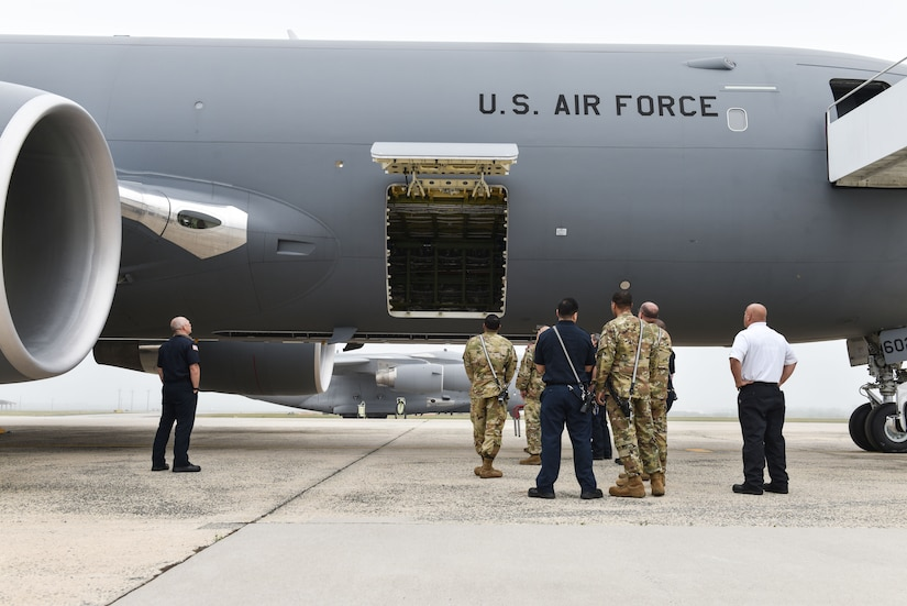 Members of the 87th Civil Engineer Squadron fire department gather around a KC-46 Pegasus during familiarization training at Joint Base McGuire-Dix-Lakehurst, N.J., May 26, 2021. The Joint Base expects to receive its first KC-46 sometime this year. (U.S. Air Force Photo by Senior Airman Shay Stuart)