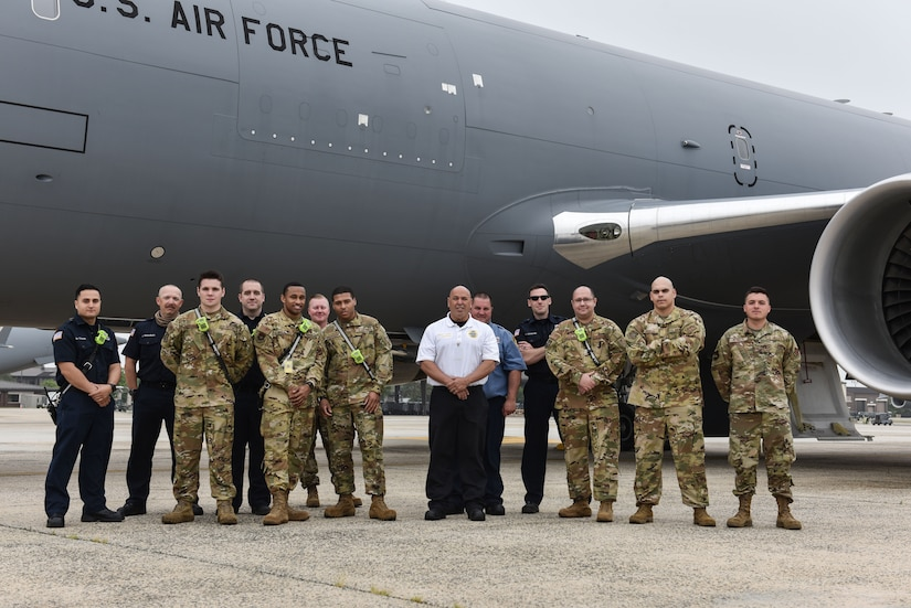 Members from the 87th Civil Engineer Squadron fire department stand alongside a KC-46 Pegasus after completing familiarization training at Joint Base McGuire-Dix-Lakehurst, N.J., May 26, 2021. The training gave 87th CES an opportunity to explore the aircraft in person and locate emergency exits and equipment for safety operations. (U.S. Air Force Photo by Senior Airman Shay Stuart)
