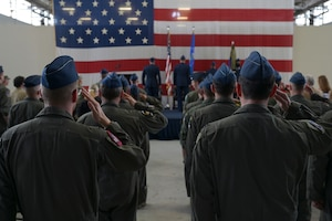 Airmen from the 37th Flying Training Squadron and audience members salute during the playing of the national anthem at the 37th FTS change of command ceremony May 27, 2021, on Columbus Air Force Base, Miss. The 37th FTS conducts primary flight training in the T-6A Texan II where students learn basic aircraft characteristics and control, takeoff and landing techniques, aerobatics, and night, instrument and formation flying. (U.S. Air Force photo by Senior Airman Jake Jacobsen)
