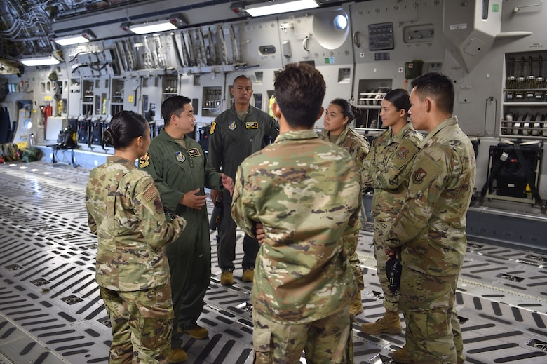TMaj. Skip Saito and Senior Master Sgt. Brandon Sarceda, both members of the 204th Airlift Squadron, meet with Asian American and Pacific Islander maintenance Airmen from the 15th and 154th Maintenance Groups before taking off on what was for most of them their first C-17 flight, on Joint Base Pearl Harbor-Hickam, Hawaii, May 25, 2021. In honor of Asian American Pacific Islander Heritage Month, the 15th Wing and 154th Wing flew a routine training mission composed with aircrew and maintainers who were all of Asian American or Pacific Islander descent and were a mix of active duty and Air National Guard members. (U.S. Air Force photo by 1st Lt. Amber R. Kelly-Herard)