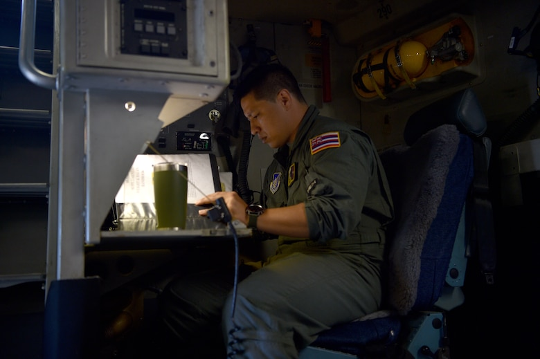 Technical Sgt. Joshua Moracco, 204th Airlift Squadron loadmaster, conducts a pre-flight checklist before taking off at Joint Base Pearl Harbor-Hickam, Hawaii, May 25, 2021. In honor of Asian American Pacific Islander Heritage Month, the 15th Wing and 154th Wing flew a routine training mission composed with aircrew and maintainers who were all of Asian American or Pacific Islander descent and were a mix of active duty and Air National Guard members. (U.S. Air Force photo by 1st Lt. Amber R. Kelly-Herard)