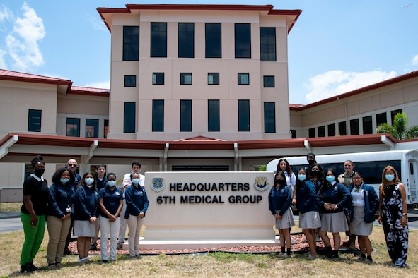 Students and faculty from Cristo Rey Tampa Salesian High School gather for a photo at MacDill Air Force Base, Florida, May 26, 2021.