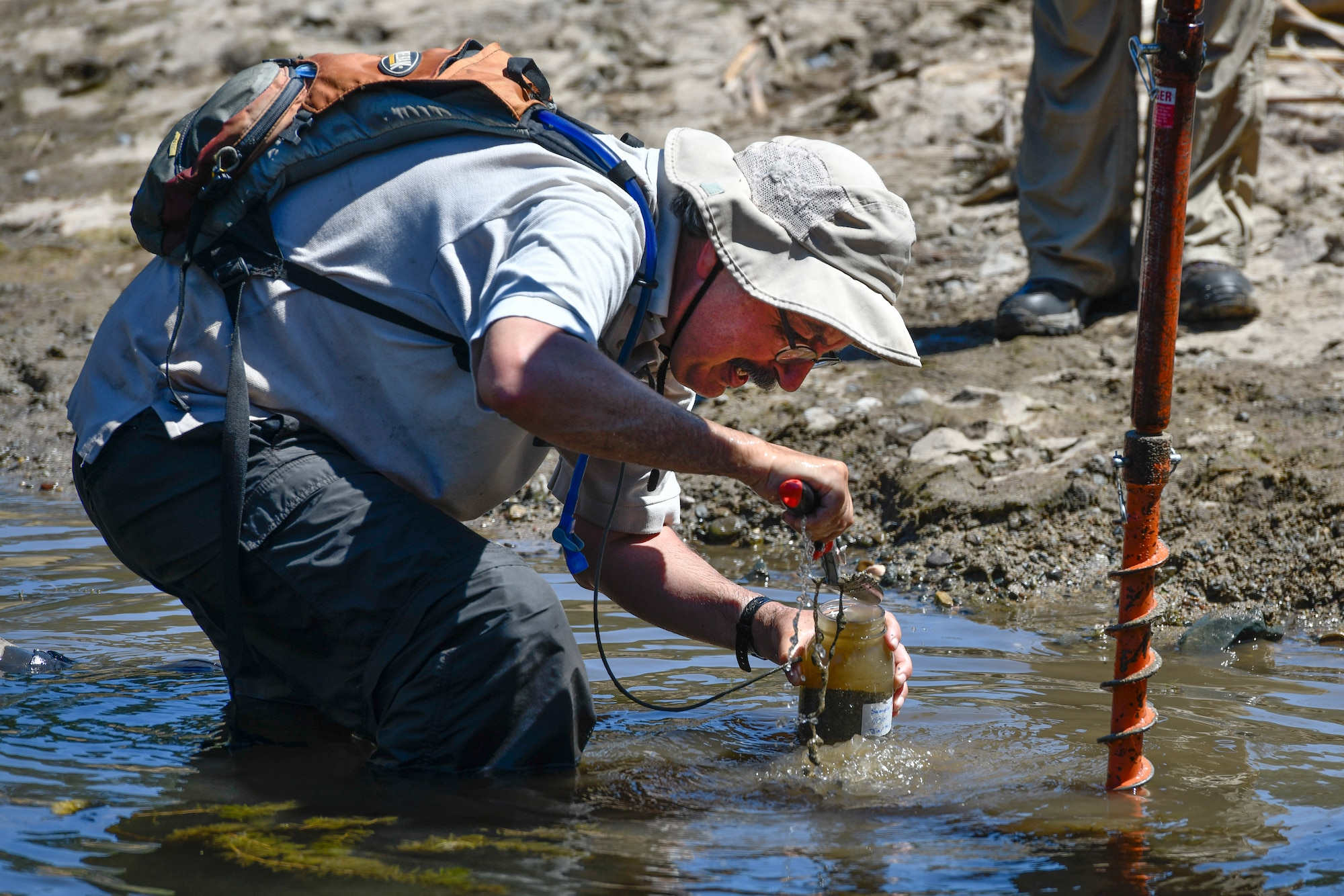 Mark Gard collects sediment samples