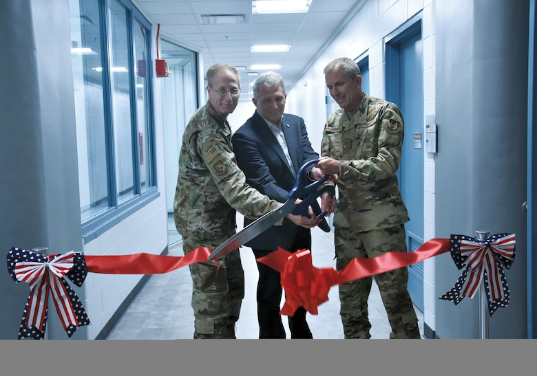 From left to right, AFRL Vice Commander Col. Paul Henderson, Materials and Manufacturing Directorate Chief Scientist Dr. Richard Vaia, and Deputy Director Col. Michael Warner cut the ribbon to open the renovated Materials Characterization Facility at Wright-Patterson Air Force Base. (U.S. Air Force photo/Spencer Deer)