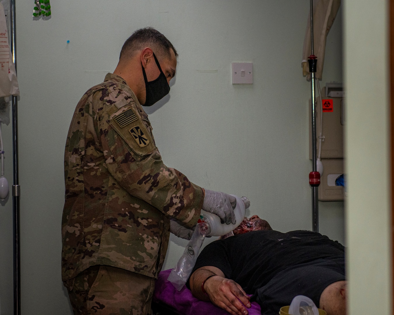 Soldier performs medial procedure on a simulated patient.