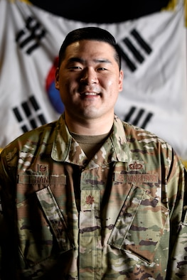 Maj. Samuel Han, 8th Comptroller Squadron commander, poses for a photo at Kunsan Air Base, Republic of Korea, May 27, 2021. Han's family immigrated from Busan, South Korea, to Mission Viejo, California, where he and his brother grew up as the only Asians in his community. He joined the Air Force to pay the nation back and thank them for the opportunities his family had since moving to the United States. (U.S. Air Force photo by Senior Airman Suzie Plotnikov)