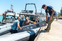 210524-N-KC128-0003 HANNOUSH, Lebanon (May 24, 2021) – Sailors assigned to Commander, Task Force 52 load an unmanned underwater vehicle aboard a rigid-hull inflatable boat during a mine-searching demonstration with members of the Lebanese Armed Forces as part of exercise Resolute Union 21 in Hannoush, Lebanon, May 24. Resolute Union 21 is an annual, bilateral explosive ordnance disposal and maritime security exercise between U.S. 5th Fleet and Lebanese Armed Forces to enhance mutual capabilities and interoperability. (U.S. Navy photo by Mass Communication Specialist 1st Class Daniel Hinton)