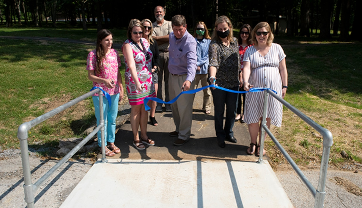 Officials with the Tennessee Health Department, Sumner County Health Department, Sumner County, and U.S. Army Corps of Engineers Nashville District dedicate a .5-mile exercise trail May 25, 2021 at Rockland Recreation Area on the shoreline of Old Hickory Lake. The ribbon cutting culminated a joint effort to construct a loop fitness trail to provide a pathway for people to safely exercise at the USACE-operated project. (USACE photo by Lee Roberts)