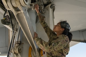 Airman 1st Class Sneha Lakshminarayanan, a crew chief with the 749th Aircraft Maintenance Squadron, works on a KC-10 Extender aircraft.