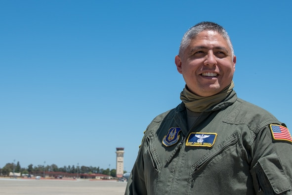 Master Sgt. Charles Yamada, 312th Airlift Squadron flight engineer, poses on the flight line at Travis Air Force Base, California.