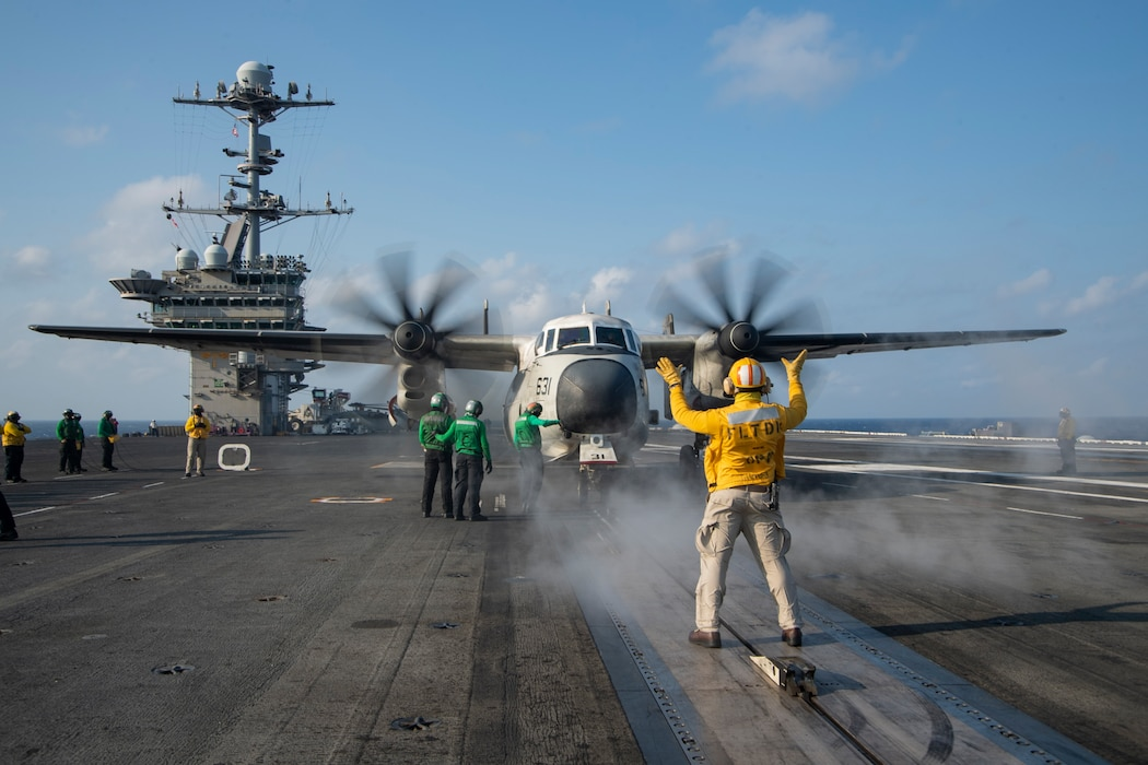 """Chief Aviation Boatswain's Mate (Handling) Jerome Gaynor Jr., from Portsmouth, Virginia, directs a C-2A Greyhound, attached to the """"Greyhawks"""" of Airborne Command and Control Squadron (VAW) 120, on the flight deck of the Nimitz-class aircraft carrier USS Harry S. Truman (CVN 75) during carrier qualifications after completing an extended incremental availability."""
