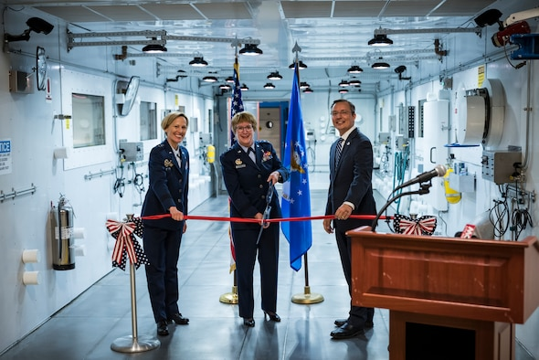 Lt. Gen. Dorothy Hogg, Air Force Surgeon General, cuts the ribbon with Air Force Research Laboratory Commander Maj. Gen. Heather Pringle and 711th Human Performance Wing Acting Director Darrell Phillipson, during a ceremony May 27 signifying the opening of the research altitude chambers in AFRL. (U.S. Air Force photo by Richard Eldridge)