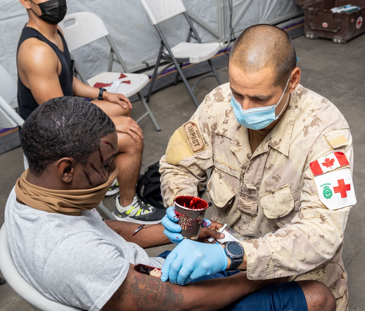 Person puts on moulage on a simulated casualty.
