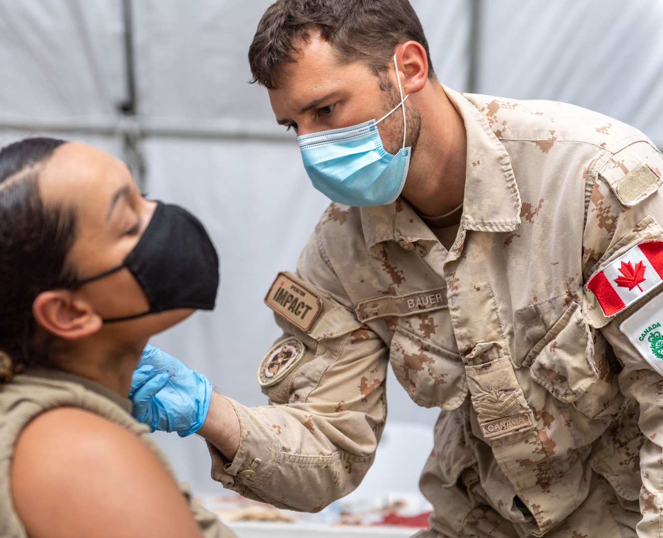 Person applies fake injuries on a simulated casualty.