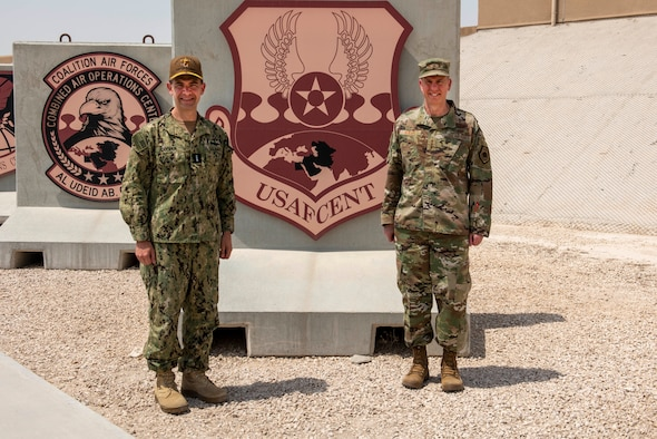 Vice Adm. Brad Cooper, U.S. Naval Forces Central Command/5th Fleet/Combined Maritime Forces commander, and Lt. Gen. Greg Guillot, 9th Air Force (Air Forces Central) commander, stand for a photo May 25, 2021, at Al Udeid Air Base, Qatar. Cooper visited the Combined Air Operations Center to observe the mission and discuss interoperability opportunities between the two commands. (U.S Air Force photo by Tech. Sgt. Dylan Nuckolls)