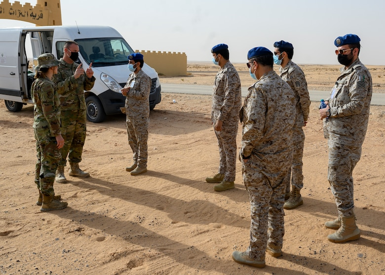 U.S. Air Force personnel from the 378th Civil Engineer Squadron emergency management flight explain the chemical, biological, radiological and nuclear defense exercise with members of the Royal Saudi Air Force, PSAB, Kingdom of Saudi Arabia, May 26, 2021. The combined exercise demonstrates the emergency management integration between USAF and RSAF CBRN response units while also familiarizing each unit with the other's techniques and procedures. (U.S. Air Force photo by Senior Airman Samuel Earick)