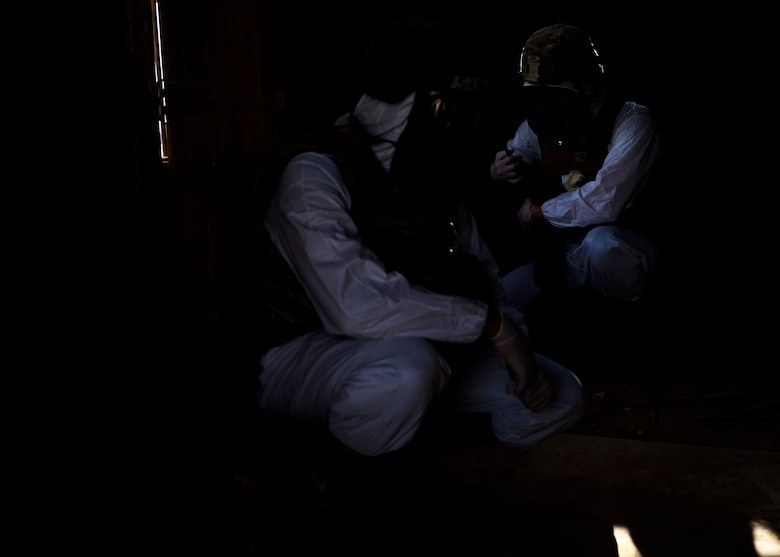 Members of the 378th Civil Engineer Squadron emergency management flight put on their Tyvek suits  during a chemical, biological, radiological and nuclear response exercise, Prince Sultan Air Base, Kingdom of Saudi Arabia, May 26, 2021. The combined exercise demonstrates the emergency management integration between USAF and RSAF CBRN response units while also familiarizing each unit with the other's techniques and procedures. (U.S. Air Force photo by Senior Airman Samuel Earick)