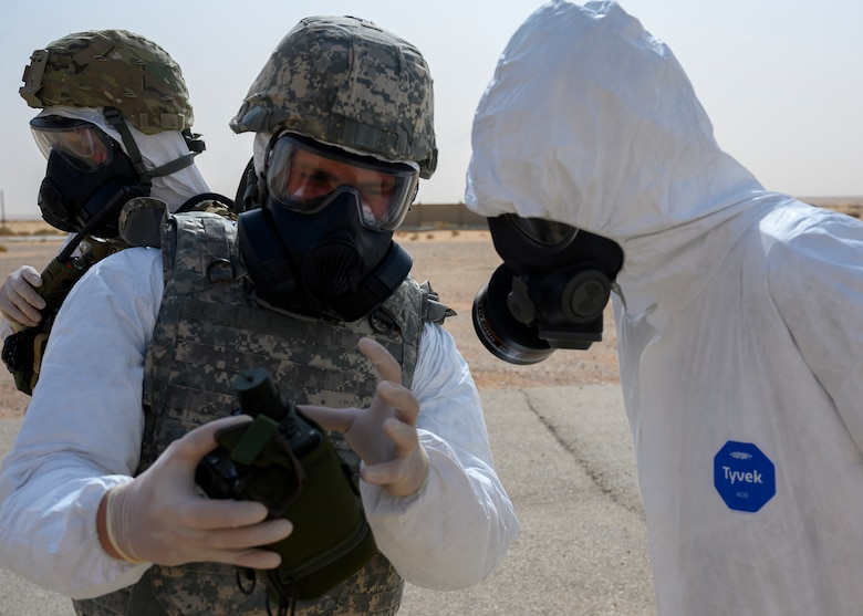 Members of the 378th Civil Engineer Squadron emergency management flight discuss the equipment necessary for a chemical, biological, radiological and nuclear response during an exercise with members of the Royal Saudi Air Force, Prince Sultan Air Base, Kingdom of Saudi Arabia, May 26, 2021. The combined exercise demonstrates the emergency management integration between USAF and RSAF CBRN response units while also familiarizing each unit with the other's techniques and procedures. (U.S. Air Force photo by Senior Airman Samuel Earick)
