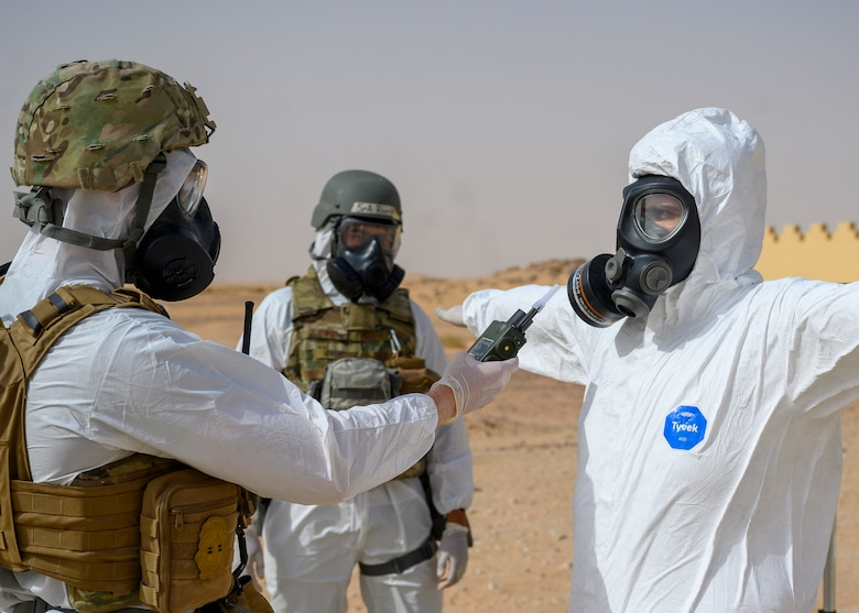 Members of the 378th Civil Engineer Squadron emergency management flight simulate checking for any contamination readings on members of the Royal Saudi Air Force after a chemical, biological, radiological and nuclear response exercise, Prince Sultan Air Base, Kingdom of Saudi Arabia, May 26, 2021. The combined exercise demonstrates the emergency management integration between USAF and RSAF CBRN response units while also familiarizing each unit with the other's techniques and procedures. (U.S. Air Force photo by Senior Airman Samuel Earick)