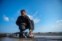 Aviation Boatswain's Mate (Equipment) Kyerra Williams, from San Bernardino, California, cleans the spreader of a catapult on the flight deck of the Nimitz-class aircraft carrier USS Harry S. Truman (CVN 75) during sea trials after completing an extended carrier incremental availability.