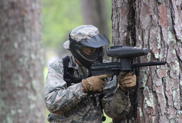 Air Force ROTC cadet takes aim during a field exercise in Puerto Rico.
