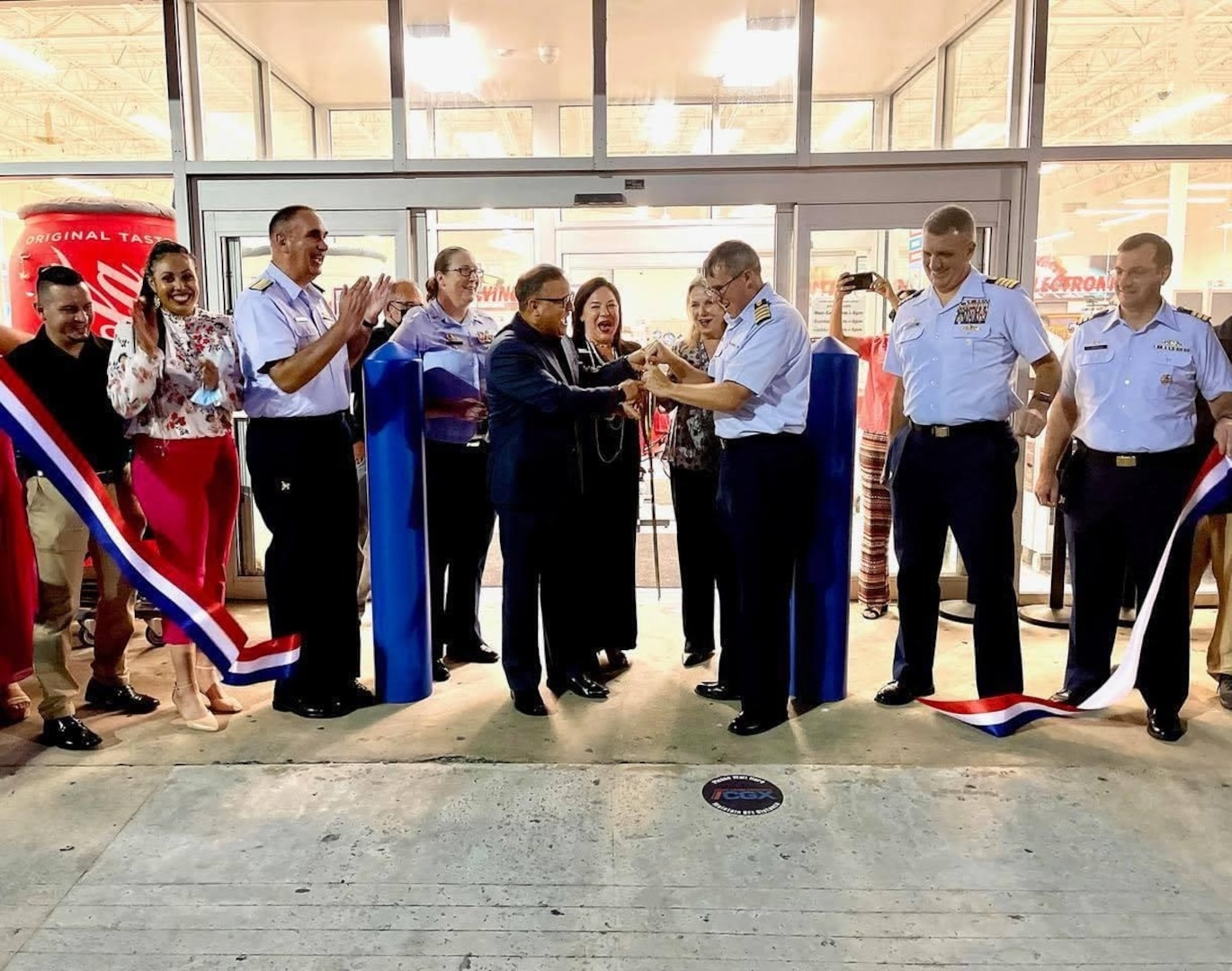 The ribbon is cut in front of the new Coast Guard Exchange in San Juan, Puerto Rico, Sept. 14, 2021. U.S. Coast Guard photo