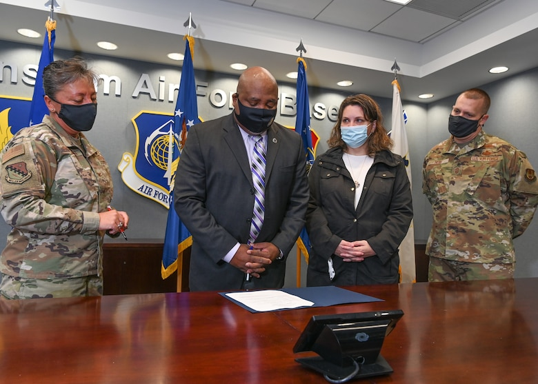 James Clarke, second from left, Hanscom Diversity, Equity and Inclusion affirmative employment program manager, reads the National Disability Employment Awareness Month proclamation to Col. Katrina Stephens, installation commander, from left, Marianne Montler, DEI disability program manager, and Chief Master Sgt. William Hebb, installation command chief, during a signing at Hanscom Air Force Base, Mass., Oct. 1. NDEAM is held each October to recognize the many and varied contributions of people with disabilities. (U.S. Air Force photo by Todd Maki)