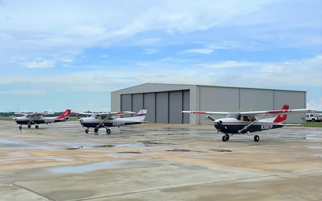 Thee Air Force Auxiliary airplanes stand ready to fly photography sorties as the weather clears