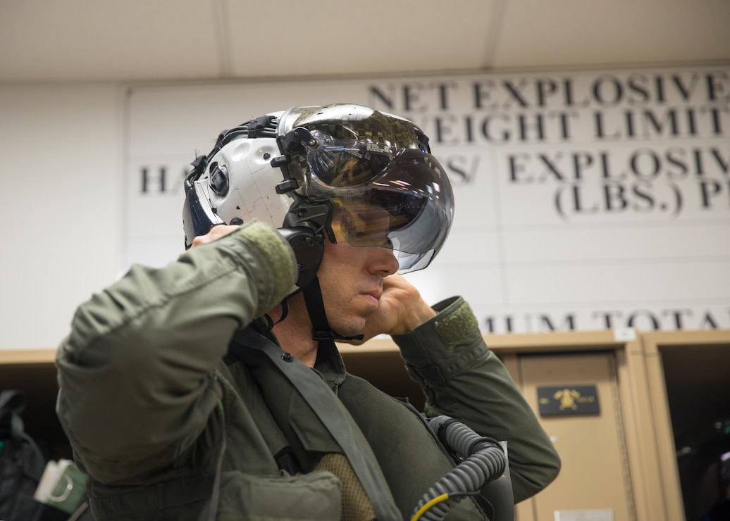 U.S. Marine Corps Lt. Col. Alexander Goodno, commanding officer of Marine Fighter Attack Squadron (VMFA) 225, tightens his helmet before heading to the flight line at Marine Corps Air Station Yuma, Ariz., September 25, 2021. VMFA-225 participated in their first flight as an F-35B squadron. This marked the end of the first phase in the transition from a legacy F/A-18D Hornet squadron to an F-35B squadron. (U.S. Marine Corps Photo by Lance Cpl. Matthew Romonoyske-Bean)